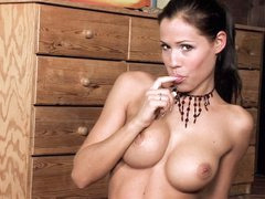 Stripped large boobed babe Satin Bloom rubs her twat