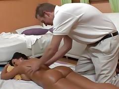 An oiled up bare Lisa Ann receives an after massage fuck