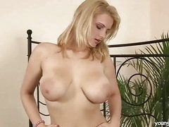 Busty golden-haired masturbating