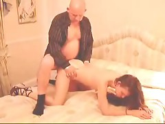 Spouse pokes his fresh thrilling wife in a doggy-style, taking her waist in his hands and helping her move at the same time.