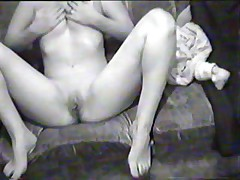 Hawt black-and-white home clip scene with breasty dark brown doing a blowjob on her boy-friend's pecker and riding it in reverse position.