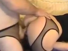 This kinky couple has a kink for filming themselves and wearing fetish outfits. With cut stockings on, they fuck hard in doggy style position until the woman groans in pleasure.