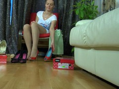 Tempting playgirl with well-maintained feet fits on recent shoes and lacy tights