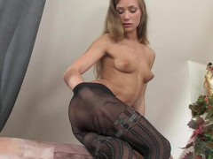Strict looking office beauty undresses to her mock hold-up tights and gets wild