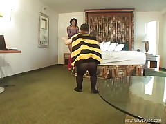 Nikki Vonn is a hot brunette playgirl and that babe is wearing a sexy pantie with high heels and fishnet dress. Now there is this midget man in a suit of a honey bee. And excited playgirl Nikki doesn't mind to be his flower! See how that babe is sucking midget bee's stinger of love and taking all the honey out of it!