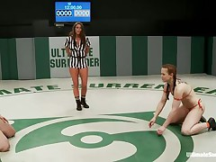 Hot bitches wearing swimsuits starts wrestling because they desire to dominate each other. The sluts are caught in difficult clutches, from which they have to escape, otherwise the other takes her brassiere or bikini off and starts licking her body. Each sexual move brings new points and the fight is tight!
