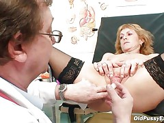 Mature blond Nora is a wench with big pantoons and large shaved cookie that is examined by a gynecologist. The doctor uses a metal speculum and gapes her cookie so we can see inside it. This wench appears to be to be healthy and her cookie is now ready for a hard fuck.