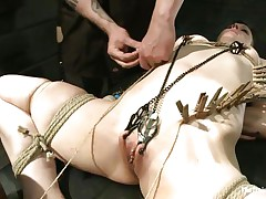 Katharine Cane is a busty dark brown milf desperately in need for punishment. Watch how Soma Snakeoil and her male friend give her what this chick wants. The hot red haired chick and her help are putting clothespins all over her body, making her scream with pleasure and pain whilst rubbing her bawdy cleft with a big vibrator.