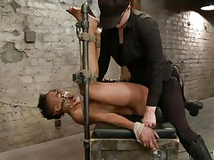 With her feet fastened up and metal clamps all over her body the swarthy wench endures a harsh punishment. This goddess knows what he's doing and gives her both pain and pleasure. This babe can't even screech as her throat is folded with scotch tape. Look at that shaved snatch and how unfathomable she's rubbing it with the vibrator.