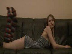 Breasty Beata coed teasing on the sofa