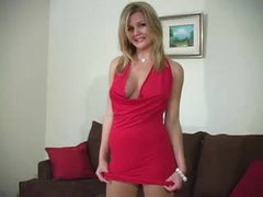 Nice-looking beauty in hose and dress tease