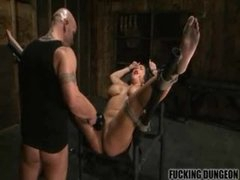 Tied doxy drilled in her moist pussy