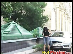 Slut shows her peeing juicy crack near a car