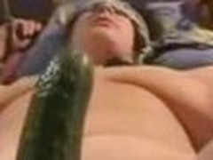 Bound up wife getting drilled with a large cucumber