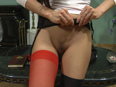 Hot gal with red stockings in her fur pie doing impure things with her sex toy