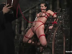 Mia Bangg is tied and gagged in the dungeon where her torturer sprays her nipple-clamped tits. He asks if she wants to receive fucked and she does, but first that guy gives her a little greater amount ache by pulling taut the rope that splits her cum-hole lips and smacks her cum-hole before using a sextoy on her.