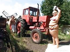 Melinda is so much woman she needs 2 men to fuck her. Tibor and Gabor lift up her overweight folds and spread her ass cheeks. The the one and the other suck on her giant mounds outside by the tractor. The rubs each part of her big overweight gorgeous body.
