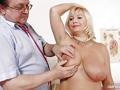 This blonde floozy is completely naked at the doctor. The doctor begins examining her large breasts with large and hawt nipples. After that that chap takes her pulse. The mature babes is sitting on the couch now with her large a-hole at the doctor. That chap start inspects her a-hole and large hairless vagina from behind.