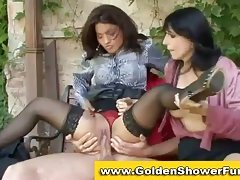 Lady pissing in sexy 3some