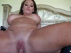 Fleshly brunette milf with large balloons rides hard weiner in bedroom