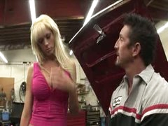 Busty blonde permeated over the car