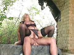 Blonde granny banged hard outdoors by huge youthful jock in butt