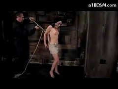 Girl With Moutgag On High Heels Getting Bound Up And Hanged Teats Tortured With Movies In The Dungeon