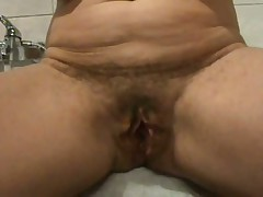 Ever wonder what an old hairy twat looks like widen wide open?  Well now u don't have to wonder as this hottie shows her loose hanging lips pulled apart for everyone to watch inside her cunt.  If you're into large loose twat lips, this one is for u as this episode is all pussy, all open. The only thing missing is that guy asshole.