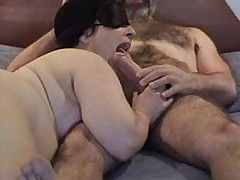 Masked overweight aged wife gives nice engulfing and licking  to her hirsute hubby\'s large jock - short but pleasant