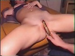 Nice-looking wife receives her bald slit filled with golden sex-toy, which her spouse pokes into her leaking twat.