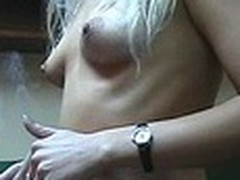 Lecherous blond sweetheart with petite sticking tits walks naked in her room filmed by her boy-friend with dilettante webcam in his hands. This chap doesn't like her smoking but really enjoys her hot nude body shyly overspread by Recent Year tree decoration :)
