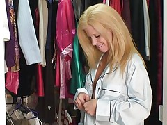 Georgie is a hot mature blonde, this sweetheart is in this cloths store and searches for something priceless to wear. We acquire to watch this hot bitch and how this sweetheart takes advantage of the situation and gropes her breasts to make us horny. Doesn't Georgie knows that this sweetheart looks more awesome naked and preferably with hard schlong between her lips?