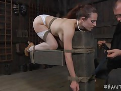 Iona Grace has a beautiful body and how the executor tied her in that position is just wonderful. The sweet milf stays there with a device that keeps her mouth opened but doesn't gags it so that chick can receive fingered in that hawt mouth and with her ass up. A metal hook is in inserted in her chocolate hole and then she's dildo drilled