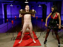 Queen Skin Diamond bound Sebastian Keys with fetters. The ebon dominatrix whips his tiny pecker until its raw and red. She makes him beg for greater amount and squeal like a kinky little piggy as she clamps his nipples and puts clothespins all over his body.