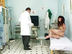 Her pussy is still constricted and nice for a hard cock to come into it but first, the gynecologist needs to check it closely and after gaping it this guy inserts a plastic speculum deep in it revealing what is inside. Her vagina looks nice on the inside but all that fucking left some mess in there so now is time for a deep, warm, milk enema.
