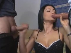 Euro girl in boots feasts on 2 dicks