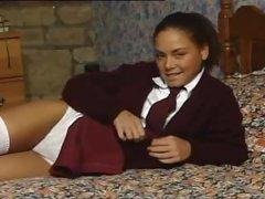 Schoolgirl does a full striptease