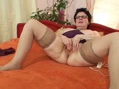 Old grandma with glasses fingering hairy cunt