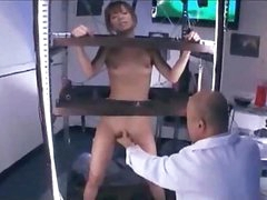 Oriental Hotty Standing In A Cage Stimulated And Drilled With Toys Getting Her Bushy Muff Licked By Man In The Lab