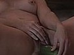Hotty laying on the ground and stuffing her hirsute cunt with a large cucumber, this sweetheart can't stop smiling too, this sweetheart just likes making non-professional masturbation videos.