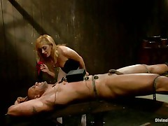 Mastix Lea enjoys playing with electricity and muscled guys. She takes her job very seriously and punishes her guy like a real dominatrix. Her blonde hair, lustful face and those sexy legs under her white pantyhose can make a guy horny, especially when he's all tied up and with electrodes on his body.