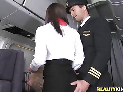 Willing for take-off captain! But previous to that, this curvy flight stewardess went down on her knees to give the pilot a blowjob! Joining the mile-high club has not at any time been this hot, especially when a beautiful brunette cabin crew strips for the captain to fondle her large ass! Bon travel passengers!