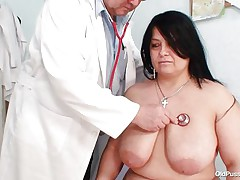 Plump brunette Rosana went to doctor's to get her body checked up well. But there is this nasty pervert doctor who makes her naked and starts playing with her firm fat body! See how this guy is toying with her biggest marangos and gaping her pussy. He even fingers it to make her horny so that this guy can screw her well!