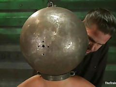 Adrianna Luna has her legs held apart by a support and her hands are encased by metal balls. Her head is encased by a metal ball as well and pumps on her nipples. This babe gets a sex tool on her snatch and gets the ok to cum. Then she's bound to a table and having clamps put on her snatch and tits. Freaky!