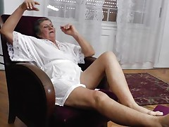 See this short haired granny masturbating in her room. This sweetheart is alone and this sweetheart needs to calm the doxy inside her who needs knobs to fuck. So this lady has only one way to survive. That is playing on her own! See how this sweetheart is groping her own tits and then rubbing her bawdy cleft before doing a nice fingering!