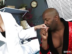 Aged busty blond doctor arrives for checkup of her patient. Black chap begins to tempt her and suggests her for ride of her lifetime. At first doctor denies but not fast and steadily comes in the charm of massive hard black cock. That man makes her naked and takes her to the bed and licks her fleshy pussy.