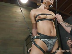 What do we have here? It's a slut, all fastened up in leather thong and hangs there expecting to be punished. This babe was a very bad hotty and her torture needs to be hard! Wenona has her face hole gagged and the executor rubs her pussy with a vibrator. Let's see if this guy has smth to stick it in her arse