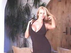 Busty pornstar in black costume striptease
