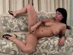 Curvy angel masturbates on the comfy daybed