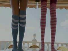 Slender sweethearts in socks enjoying free time